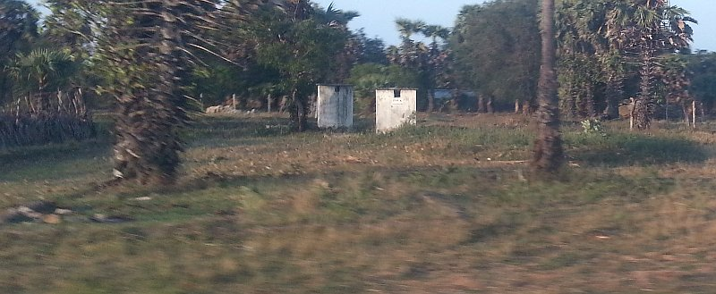 Latrines --all that is left of the homes after the war