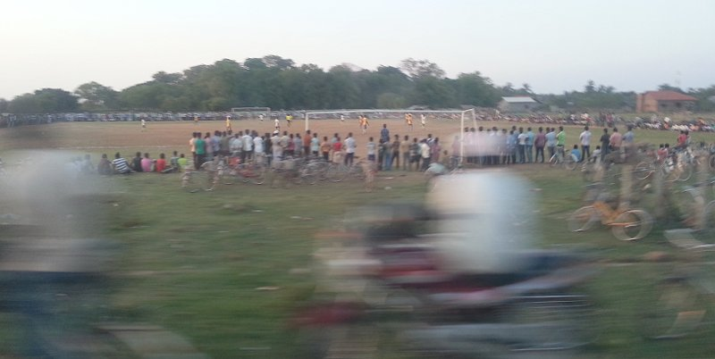 Soccer match, probably between two rival towns